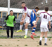 Westside Eagle Observer/MIKE ECKELS<br /> <br /> Pioneer Jony Ochoa (left) and Bulldog Marvin Gramajo go airborne in an attempt to either block the shoot or kick it into the net during the closing minutes of the Decatur-Gentry soccer match at Bulldogs Stadium March 4.