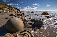 A popular tourist attraction - the Moeraki Boulders are spherical concretions on the beach at Moeraki, Coastal Otago, New Zealand - stock photo, canvas, fine art print