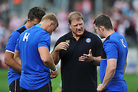 Bath Rugby Forwards coach Neal Hatley speaks to a few forwards during the pre-match warm-up. West Country Challenge Cup match, between Gloucester Rugby and Bath Rugby on September 13, 2015 at the Memorial Stadium in Bristol, England. Photo by: Patrick Khachfe / Onside Images