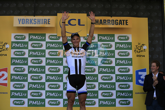Marcel Kittel (GER) Team Giant-Shimano wins Stage 1 and wears the 1st Green Jersey at the end of the 2014 Tour de France running 190.5km from Leeds to Harrogate. 5th July 2014.<br /> Picture: Eoin Clarke www.newsfile.ie
