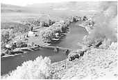 Train along Gunnison River - suspension foot bridge across river.  Farm across river from train.  (Area may now be under water.)<br /> D&amp;RGW  Elk Creek, CO  Taken by Richardson, Robert W. - 10/5/1954