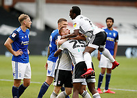 4th July 2020; Craven Cottage, London, England; English Championship Football, Fulham versus Birmingham City; Joshua Onomah of Fulham celebrates with his team mates after scoring his sides 1st goal in the 96th minute to make it 1-0