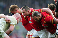 The Wales front row of Tomas Francis, Ken Owens and Paul James pack down for a scrum. RBS Six Nations match between England and Wales on March 12, 2016 at Twickenham Stadium in London, England. Photo by: Patrick Khachfe / Onside Images