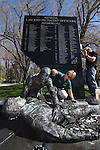 Nevada Legislative Police Sgt. Teri Greene and Ofc. Bob McDonald clean the state Law Enforcement Memorial on Wednesday, May 4, 2011 on the Capitol grounds in Carson City, Nev., in preparation for Thursday's 12th annual ceremony honoring Nevada officers killed in the line of duty..Photo by Cathleen Allison