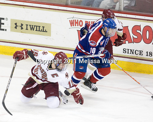 Joe Whitney (BC - 15), David Vallorani (Lowell - 10), Brian Gibbons (BC - 17) - The Boston College Eagles defeated the visiting University of Massachusetts-Lowell River Hawks 5-3 (EN) on Saturday, January 22, 2011, at Conte Forum in Chestnut Hill, Massachusetts.