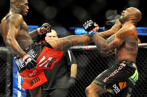 "24.09.2011. Denver, Colorado. Jon ""Bones"" Jones lands a kick on the bloodied face of Quinton ""Rampage"" Jackson during UFC 135 at the Pepsi Center in Denver, Colorado."