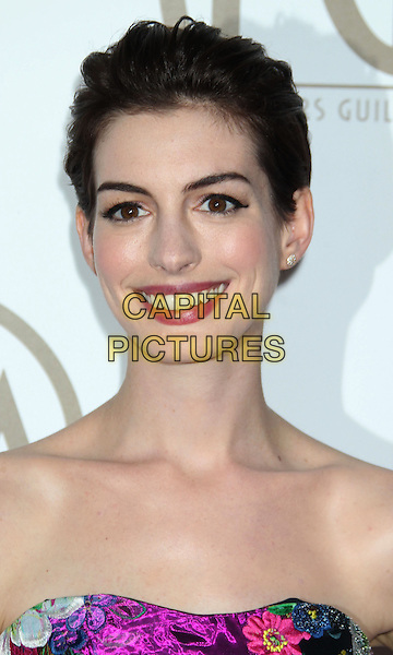 Anne Hathaway.At the 24th Annual Producers Guild Awards held at the Beverly Hilton Hotel, Beverly Hills, California, USA,.26th January 2013..PGAs PGA arrivals headshot portrait   strapless floral print smiling purple pink green yellow black .CAP/ADM/RE.©Russ Elliot/AdMedia/Capital Pictures.