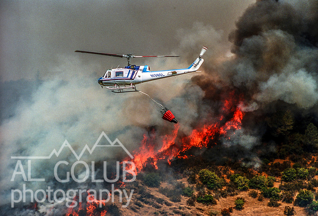 August 17, 1992 Angels Camp, California -- Old Gulch Fire— Helicopter returns to water source after making drop near Old Gulch Road.  The Old Gulch Fire raged over some 18,000 acres, destroying 42 homes while threatening the Mother Lode communities of Murphys, Sheep Ranch, Avery and Forest Meadows.