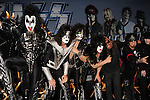 HOLLYWOOD, CA - MARCH 20: Gene Simmons, Tommy Thayer, Eric Singer, Paul Stanley of Kiss and Vince Neil Nikki Sixx, Mick Mars and Tommy Lee of Motley Crue attend the 'Kiss, Motley Crue: The Tour' Press Conference at Hollywood Roosevelt Hotel on March 20, 2012 in Hollywood, California.