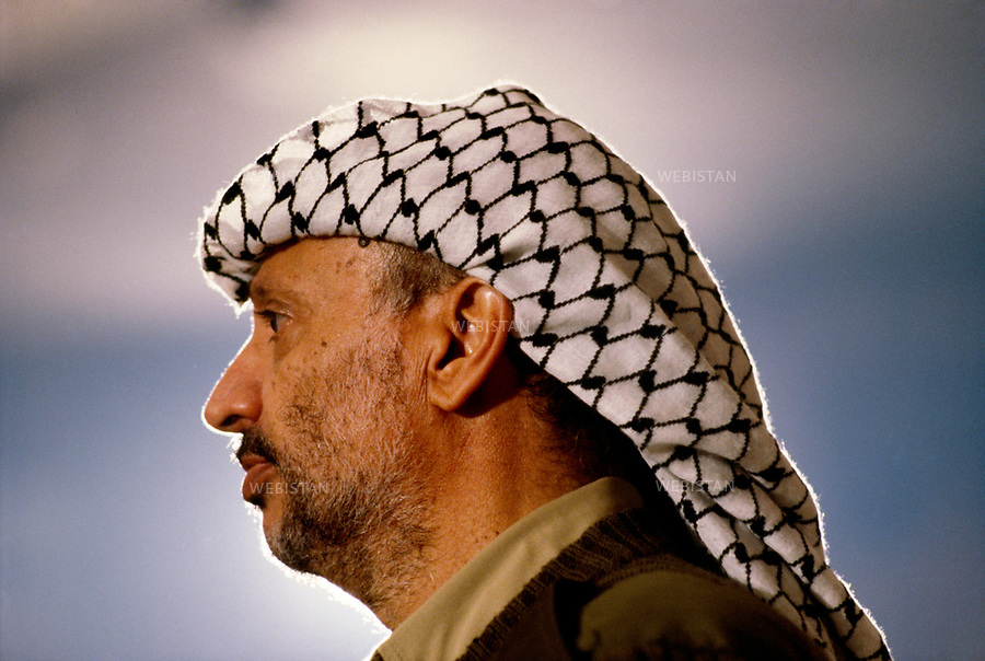 1984. Jordan. Amman. Portrait of Yasser Arafat (1929-2004), chairman of the PLO, at the 17th meeting of the Palestinian National Council (PNC). Jordanie. Amman. Portrait de Yasser Arafat (1929-2004), le chef de l'OLP, à la 17e réunion du Conseil National Palestinien (CNP).