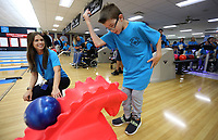 NWA Democrat-Gazette/DAVID GOTTSCHALK Marleah Hannaford (left), special education teacher at Lincoln Junior High School, watches as Brody Rice, a seventh grade student, bowls Wednesday, November 6, 2019, at the Rogers Bowling Center in Rogers. Rice was competing in the two day Special Olympics of Arkansas Area Bowling Competition. Schools from eight districts participated in the competition.