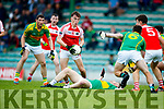 Oran Clifford South Kerry in action against Cathal Bambury Dingle in the Quarter Final of the Kerry Senior County Championship at Austin Stack Park on Sunday.