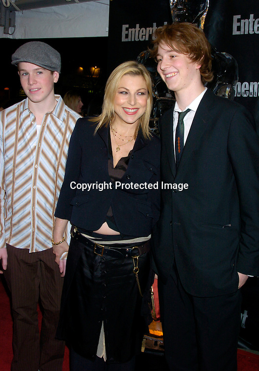 Tatum O'Neal and sons Sean and Kevin McEnroe ..at the Entertainment Weekly 10th annual Oscar Party on ..February 29, 2004 at Elaine's in New YOrk City. Photo by Robin Platzer, Twin Images