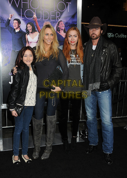 Noah Cyrus, Tish Cyrus, Brandi Cyrus and Billy Ray Cyrus.'Joyful Noise' Los Angeles premiere held at Grauman's Chinese Theatre, Hollywood, California, USA..9th January 2012 .full length jeans denim leather jacket hands in pockets black grey gray scarf beard facial hair hat brown married husband wife kids children family white top grey gray boots .CAP/ADM/BP.©Byron Purvis/AdMedia/Capital Pictures.