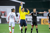 Washington, D.C.- March 29, 2014. MLS Referee Jorge Gonzalez. D.C. United defeated the New England Revolution 2-0 during a Major League Soccer Match for the 2014 season at RFK Stadium.