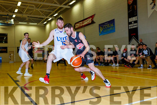 Mark Greene Scotts Lakers goes past Michael Leadley Donegal during their game in Killarney Saturday night