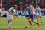 Atletico de Madrid´s Raul Jimenez (R) and Deportivo de la Coruña´s Laure (L) during 2014-15 La Liga match between Atletico de Madrid and Deportivo de la Coruña at Vicente Calderon stadium in Madrid, Spain. November 30, 2014. (ALTERPHOTOS/Victor Blanco)