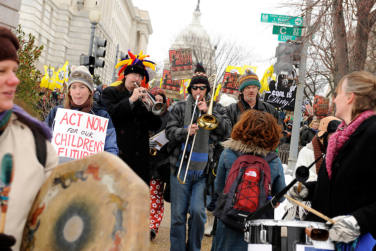 Participants in the Capitol Climate Action Coalition protest of the use of coal by the Capitol Power Plant play instruments as they make their way to the plant where they blocked four entrances, March 2, 2009.