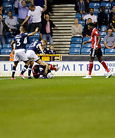 Ipswich Town's Joe Garner gets unwanted attention from Millwall's George Saville during the Sky Bet Championship match between Millwall and Ipswich Town at The Den, London, England on 15 August 2017. Photo by Carlton Myrie.