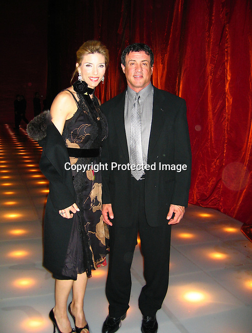 Sylvester Stallone and wife Jennifer Flavin<br />Louis Vuitton United Cancer Gala<br />Universal Studios<br />Universal City, Los Angeles, CA, USA<br />Monday, November 08, 2004<br />Photo By Celebrityvibe.com/Photovibe.com, New York, USA, Phone 212 410 5354, email:sales@celebrityvibe.com