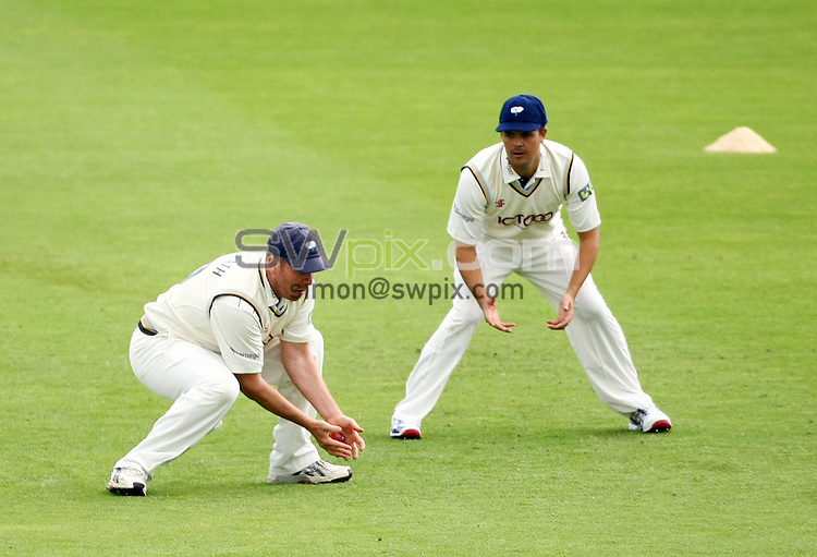 PICTURE BY VAUGHN RIDLEY/SWPIX.COM...Cricket - County Championship - Yorkshire v Lancashire, Day 1 - Headingley, Leeds, England - 20/07/11...Yorkshire's Anthony McGrath catches out Lancashire's Mark Chilton.