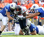 30 September 2006: Virginia's Emmanuel Byers (center) is tackled by Duke's Codey Lowe (58), Eli Nichols (52), and Patrick Bailey (84). The Duke University Blue Devils lost 37-0 to the University of Virginia Cavaliers at Wallace Wade Stadium in Durham, North Carolina in an Atlantic Coast Conference NCAA Division I College Football game.