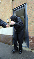 Pictured: Robert Riley is led handcuffed to a waiting prison van after being sentenced by Swansea Magistrates. Thursday 08 May 2014<br /> Re: A man who admitted posting abusive Twitter messages about the death of school teacher Ann Maguire has been jailed for 8 weeks by Swansea Magistrates Court this morning.<br /> Robert Riley, from Port Talbot, South Wales, had appeared before magistrates in Leeds where he admitted sending a message of a grossly offensive, abusive or malicious character.<br /> Mrs Maguire, 61, was stabbed to death in her classroom in Leeds a week ago.