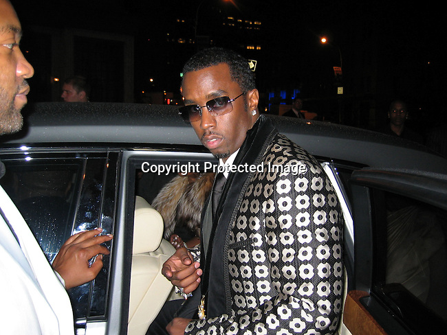 Sean P. Diddy Combs getting into his car infront of PM <br />