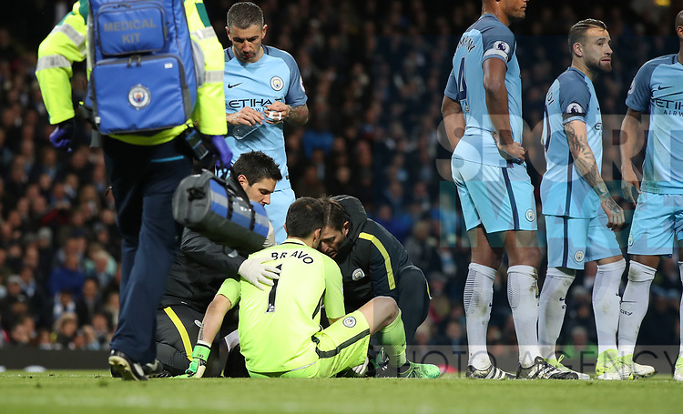 Claudio Bravo of Manchester City  is injured during the English Premier League match at The Etihad Stadium, Manchester. Picture date: April 27th, 2016. Photo credit should read: Lynne Cameron/Sportimage