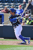 Omaha Storm Chasers third baseman Cheslor Cuthbert (24) swings against the Round Rock Express at Werner Park on April 12, 2016 in Omaha, Nebraska.  The Express won 6-4.  (Dennis Hubbard/Four Seam Images)