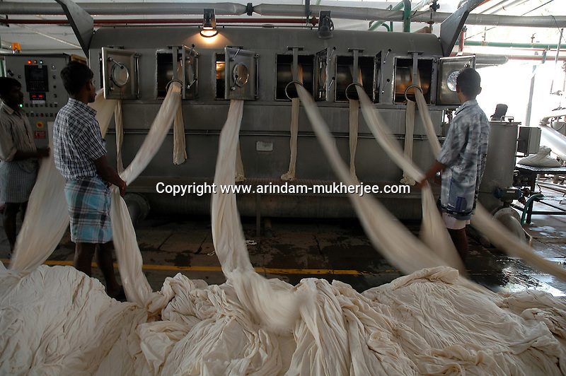 Indian men working at Prem Textile Industry's garment dyeing factory in Tirupur, Tamilnadu. After lifting of quota system in textile export on 1st january 2005. Tirupur has become the biggest foreign currency earning town of India.