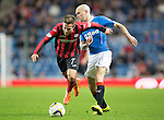 Rangers v St Johnstone....28.10.14   Scottish League Cup Quarter Final at Ibrox<br /> Chris Millar is fouled by Nicky Law<br /> Picture by Graeme Hart.<br /> Copyright Perthshire Picture Agency<br /> Tel: 01738 623350  Mobile: 07990 594431