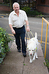Man with his guide dog visiting the Nottingham Royal Society for the Blind ,NRSB,. MR