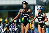 24 JUL 2014 - GLASGOW, GBR - Fabienne St. Louis (MRI) (left) from Mauritius and her team mate Emilie Ng Foong Po (MRI) race through transition for the start of the bike during the elite women's 2014 Commonwealth Games triathlon in Strathclyde Country Park, in Glasgow, Scotland (PHOTO COPYRIGHT &copy; 2014 NIGEL FARROW, ALL RIGHTS RESERVED)<br /> *******************************<br /> COMMONWEALTH GAMES <br /> FEDERATION USAGE <br /> RULES APPLY<br /> *******************************