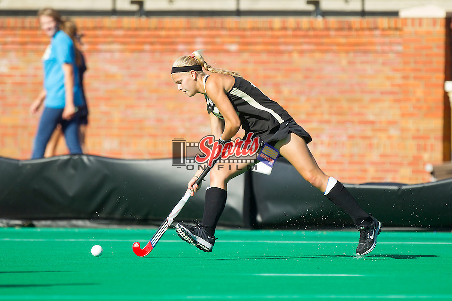Krysta Wangerin (15) of the Wake Forest Demon Deacons controls the ball during first half action against the Liberty Flames at Kentner Stadium on September 13, 2013 in Winston-Salem, North Carolina.  The Demon Deacons defeated the Flames 3-2.  (Brian Westerholt/Sports On Film)