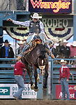 Troy Crowser competes in the saddle bronc event at the Reno Rodeo, in Reno, Nev. on Friday night, June 22, 2012..Photo by Cathleen Allison