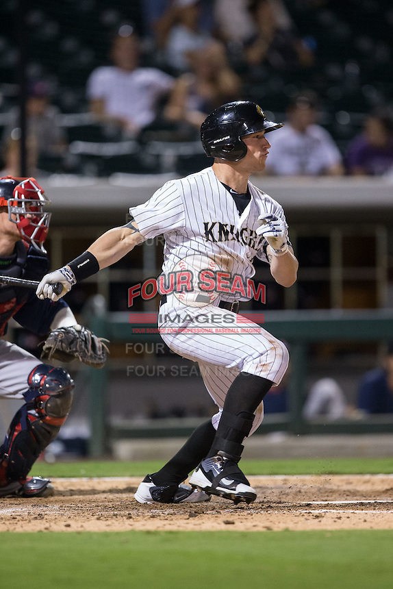 Slade Heathcott (26) of the Charlotte Knights follows through on his swing against the Pawtucket Red Sox at BB&T BallPark on July 6, 2016 in Charlotte, North Carolina.  The Knights defeated the Red Sox 8-6.  (Brian Westerholt/Four Seam Images)