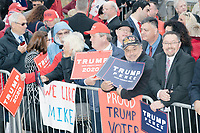 A small crowd of Trump supporters wait to greet Vice President Mike Pence after he leaves the New Hampshire Secretary of State's office in the New Hampshire State House in Concord, New Hampshire, on Thu., November 7, 2019. Pence traveled to New Hampshire as a surrogate for Donald Trump to file required paperwork for the president to get on the New Hampshire presidential primary ballot in 2020. The required documents include a filing form signed by the candidate and a $1000 filing fee.