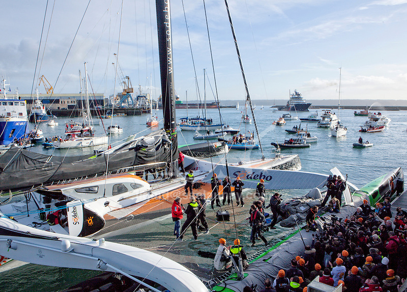 Thomas Coville (FRA) and his 31m maxi trimaran Sodebo Ultim' has successfully broken the solo round the world record, completing the 28400 nm route in 49 days 3 hours 7 minutes and 38 seconds. Brest, France.