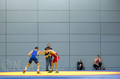 11 MAY 2014 - SHEFFIELD, GBR - Competitors look for an opening to attack during a match at the British 2014 Senior Wrestling Championships at EIS in Sheffield, Great Britain (PHOTO COPYRIGHT © 2014 NIGEL FARROW, ALL RIGHTS RESERVED)