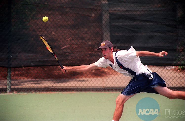 Caption: 19 May 1996: Jonathan Harper of UC Snata Cruz stretches for a volly in his doubles match with Brian Cummings which they won during NCAA Division 3 Men's Tennis National Championships at the Woodruff Physical Education Center in Atlanta, GA. UC Santa Cruz defeated Emory 4-2 to win the Championship. Johnny Crawford/NCAA Photos