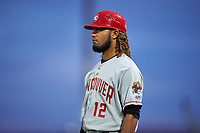 Vancouver Canadians Ronny Brito (12) coaches first base during a Northwest League game against the Tri-City Dust Devils at Gesa Stadium on August 21, 2019 in Pasco, Washington. Vancouver defeated Tri-City 1-0. (Zachary Lucy/Four Seam Images)