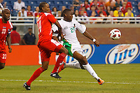 7 June 2011: Guadeloupe forward Richard Socrier (21) goes for the ball as Panama defender Eduardo Dasent (14) defends during the CONCACAF soccer match between Panama and Guadeloupe at Ford Field Detroit, Michigan.