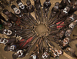 The Karo are one of numerous ethnic tribes inhabiting the barren lands of southwestern Ethiopia. These Karo youngsters humored me by sitting in a circle so I could photograph the pattern of their bare feet.