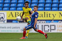 Curtis Nelson of Oxford United clears the ball under pressure from Ricky Miller of Peterborough United during the Sky Bet League 1 match between Peterborough and Oxford United at the ABAX Stadium, London Road, Peterborough, England on 30 September 2017. Photo by David Horn.