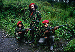 Falintil Commander Cornelio Gama, with two female members of his guerrilla force. <br />