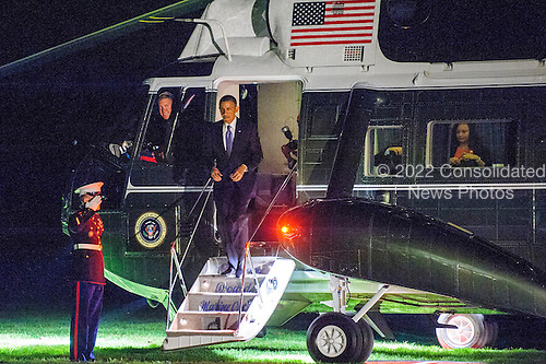 United States President Barack Obama disembarks from Marine One on the South Lawn of the White House  in Washington, D.C., U.S., on Monday, May 13, 2013. The President was returning from New York City where he attended two DNC events at private residences and a joint DCCC/DSCC event at the Waldorf Astoria Hotel. <br /> Credit: Pete Marovich / Pool via CNP