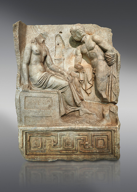 """Roman Sebasteion relief  sculpture of Io and Argos Aphrodisias Museum, Aphrodisias, Turkey. <br /> <br /> A powerful hero is folding a sword gazing closely at a half naked and dishevelled young heroine who sits on a chest like stool. Between, on a pillar base stood a small, separately added statue of a goddess ( now missing). The scene follows a scheme used in the relief panels """"Io guarded by Argos"""". Io was one of Zeus's lovers, and Argos was a watchful giant sent to guard her by Hera, Zeus's wife."""