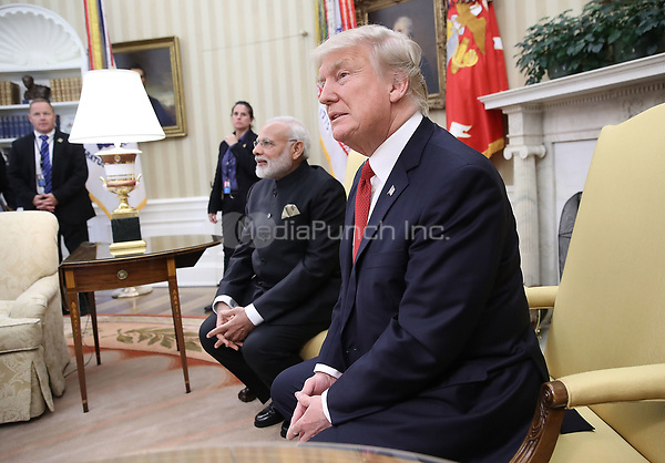 United States President Donald Trump meets with Indian Prime Minister Narendra Modi in the Oval Office of the White House June 26, 2017 in Washington, DC. Trump and Modi are scheduled to deliver joint statements later today following their meetings.   <br /> Credit: Win McNamee / Pool via CNP /MediaPunch