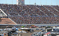 Mar 2, 2008; Las Vegas, NV, USA; NASCAR Sprint Cup Series drivers Kyle Busch (18) leads the field during the UAW Dodge 400 at Las Vegas Motor Speedway. Mandatory Credit: Mark J. Rebilas-US PRESSWIRE